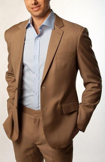 Exploring the psychological meanings behind the color brown in men's fashion. Examining the effect a brown mens suit has on people.