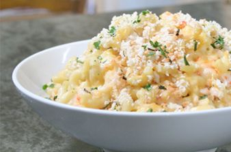Shrimp macaroni & cheese: 1 pound elbow macaroni * 2 tbsp unsalted butter * ¼ cup all-purpose flour * 3 cups skim milk * 2 cups shredded cheddar cheese * 1¼ cup grated parmesan cheese * 1 pound frozen shrimp, chopped and cooked * ½ cup panko pread crumbs * 2 tbsp fresh parsley, chopped * salt and freshly ground black pepper, to taste
