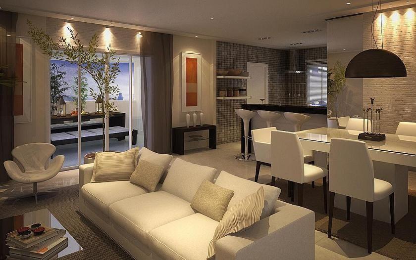 Sala de estar, jantar e cozinha integradas.