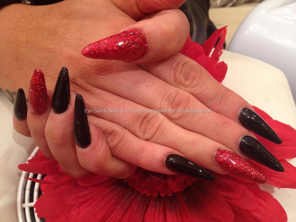 Stiletto Nails With Black Polish And Red Glitter Gel