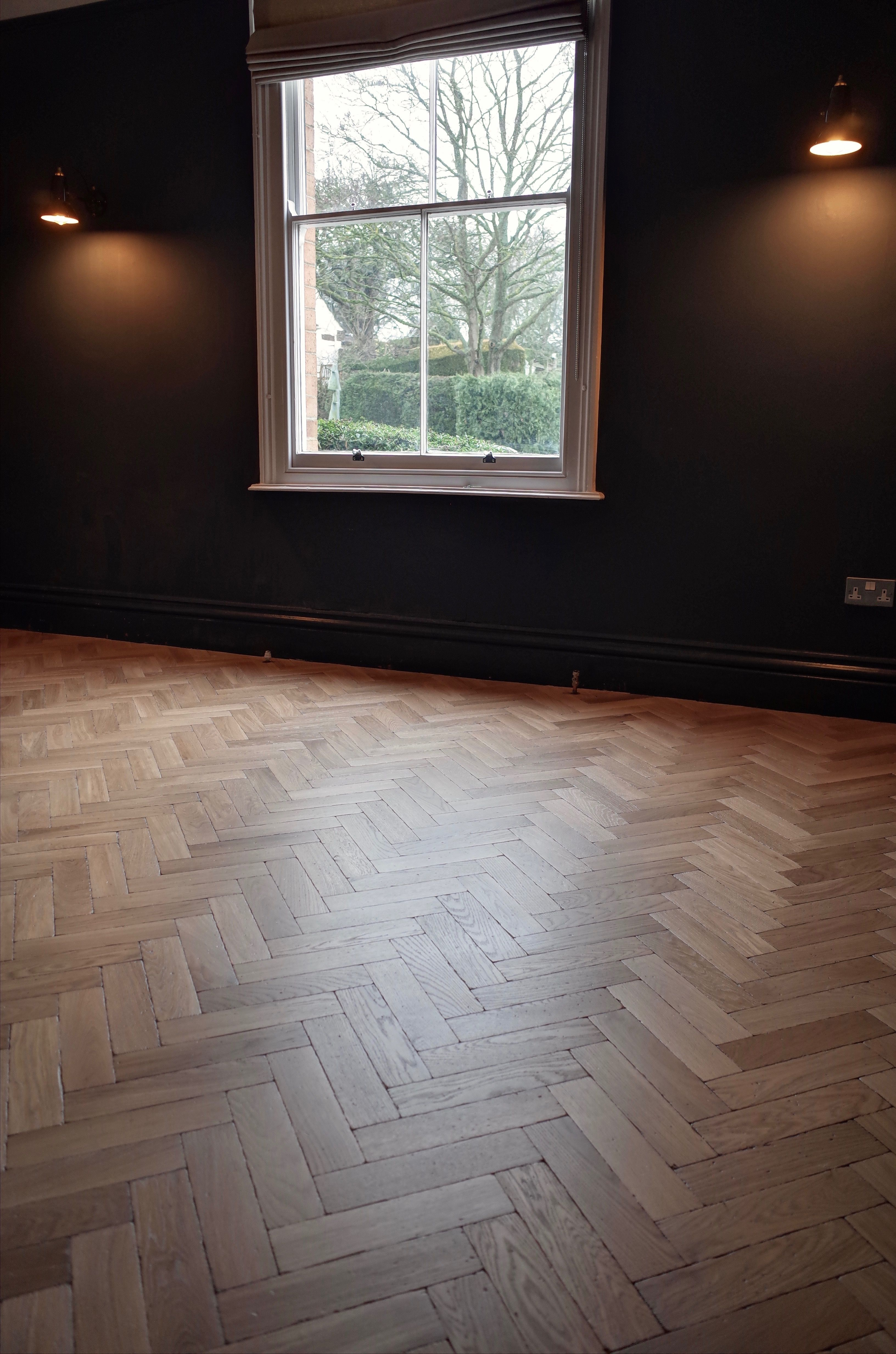 Distressed white oiled solid oak parquet flooring in east