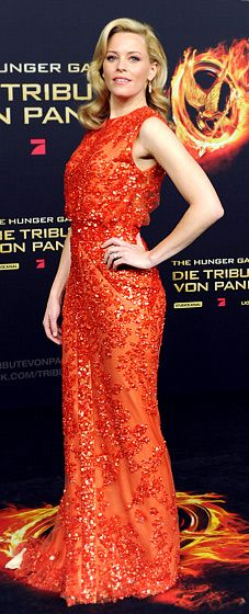 in an orange embellished Elie Saab gown