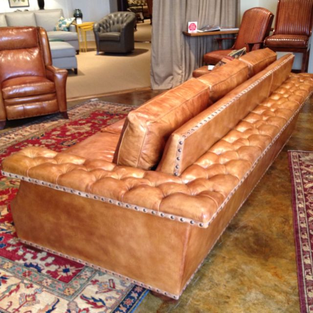 Hancock & Moore Window seat leather sofa:  designed to invite guests to perch on the frame. The tufting gives it such a classic style.  I'd love to see this sofa floating in a family room or with the back facing a pool table.  Extra seating when you entertain! 200 Steele