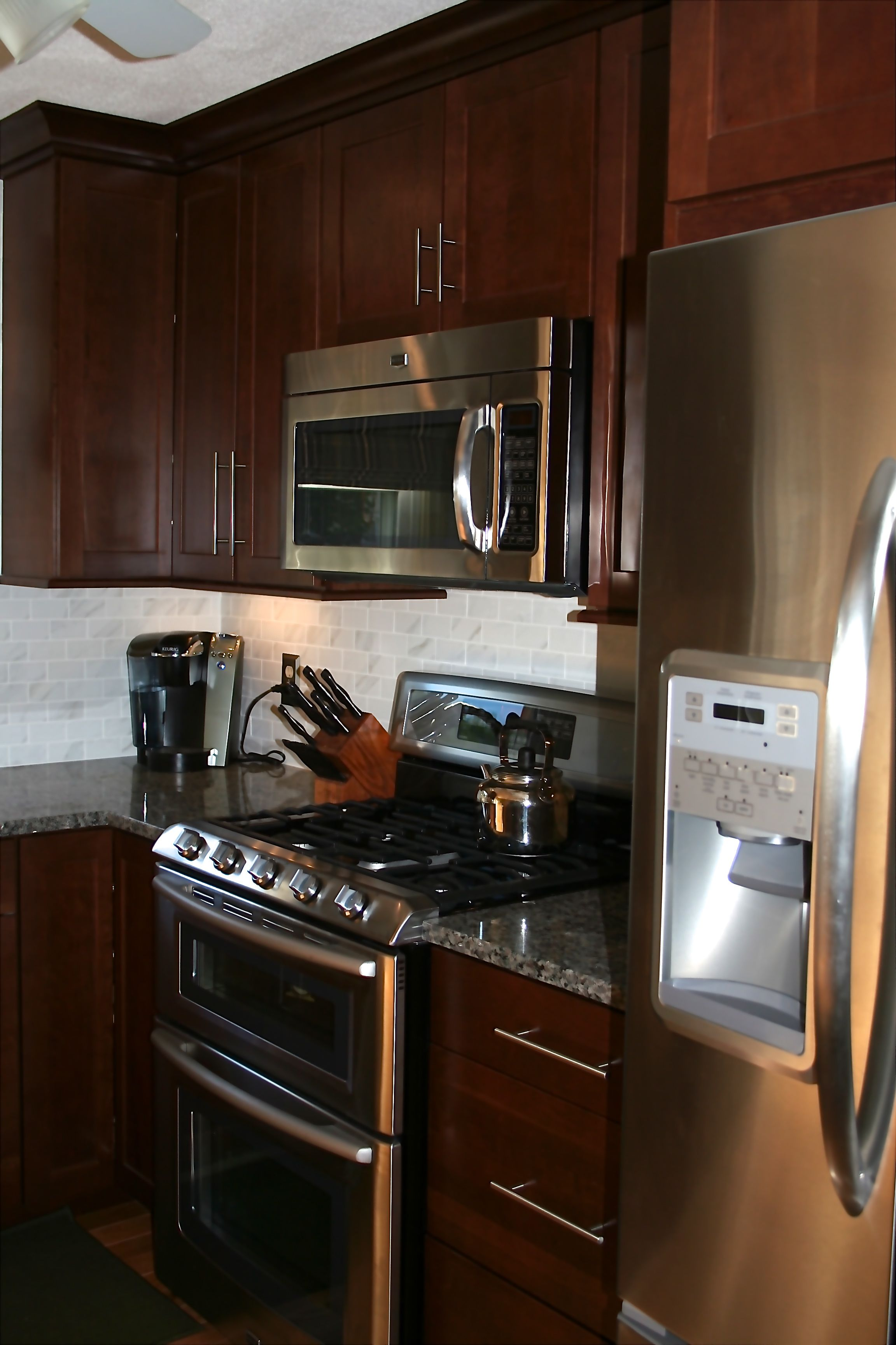 waypoint kitchen cabinets outdoor islands cabinetry in cherry spice cove molding stainless