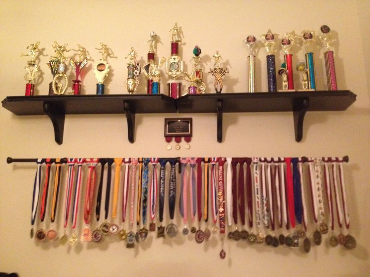Display For Gymnastics Trophies And Medals.unlimited # Of Medals With Using  A Rod As Opposed To Hangars