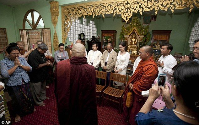 Angelina Jolie prays with religious leaders from Myanmar Interfaith Group during their meeting at a monastery in Burma earlier today
