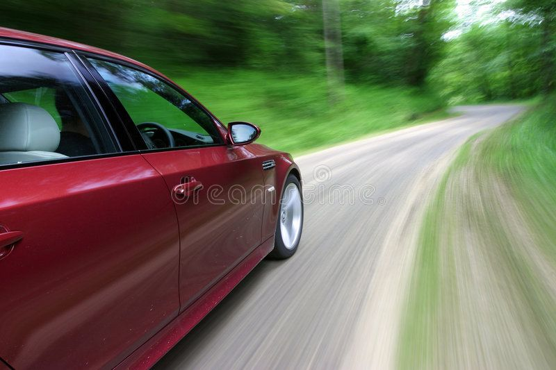Car in Motion. Red Moving along a Country Road ,