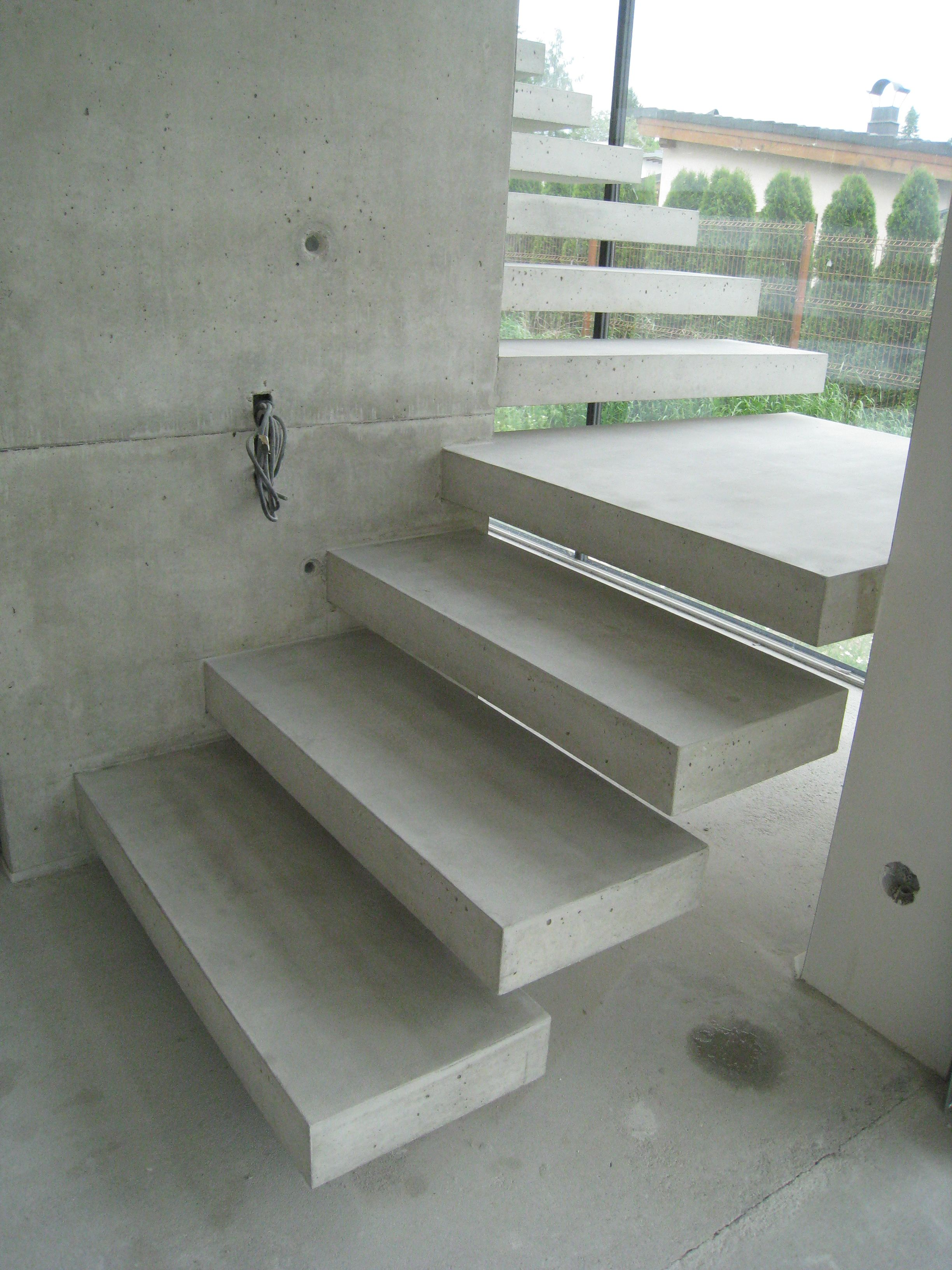 Floating concrete stairs and landing stairs we love at for Pre built stairs interior
