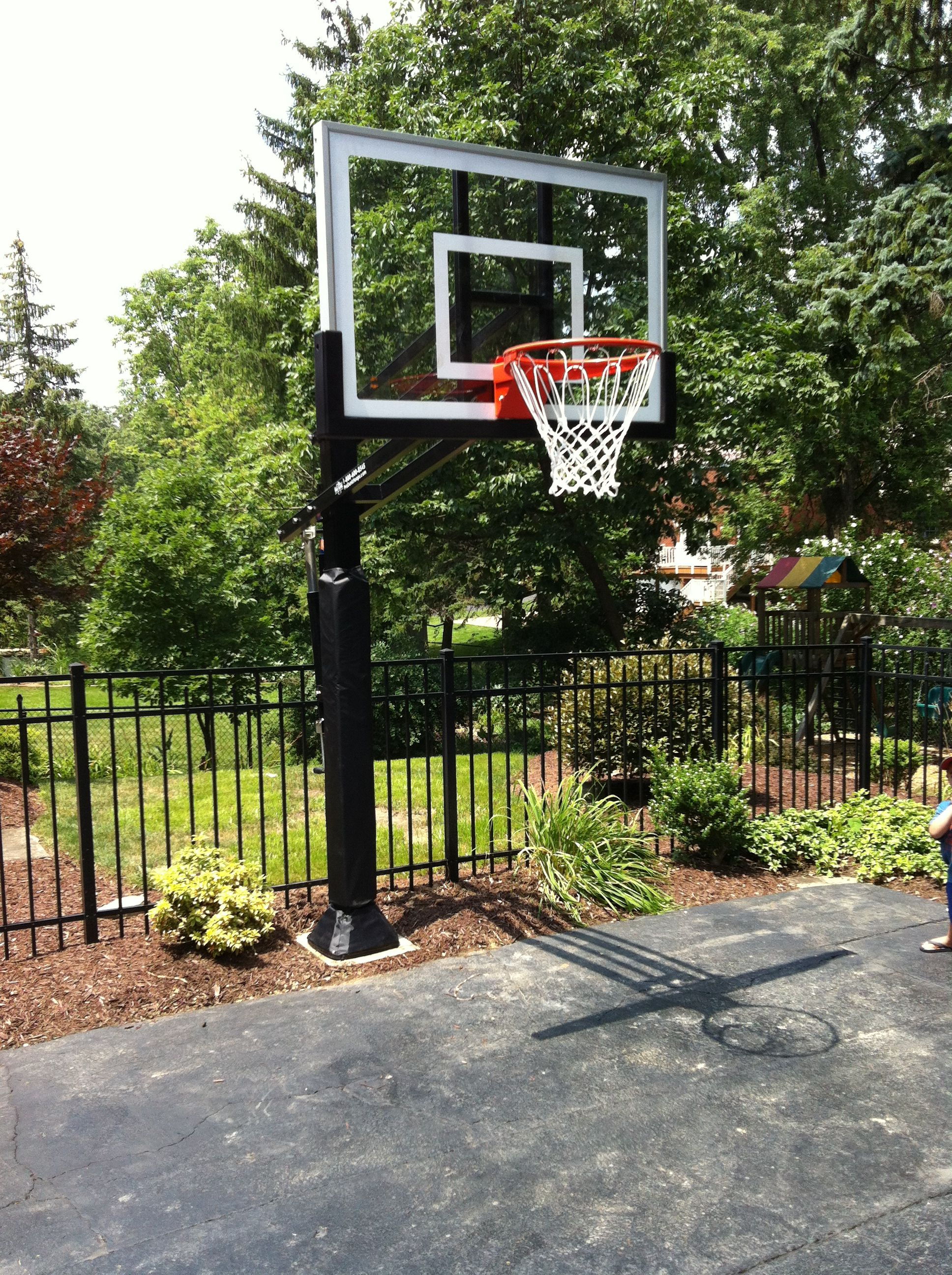 There Is A Pro Dunk Silver Basketball System On The Side Of Asphalt Concrete Blacktop Driveway