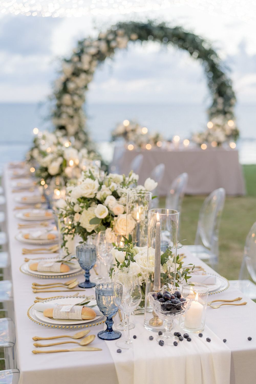Picture this: A lush circular ceremony arch of white roses on the beaches of Phuket and an intimate outdoor wedding reception under twinkling lights. This gorgeous destination wedding has us packing our bags and jet setting to Thailand!