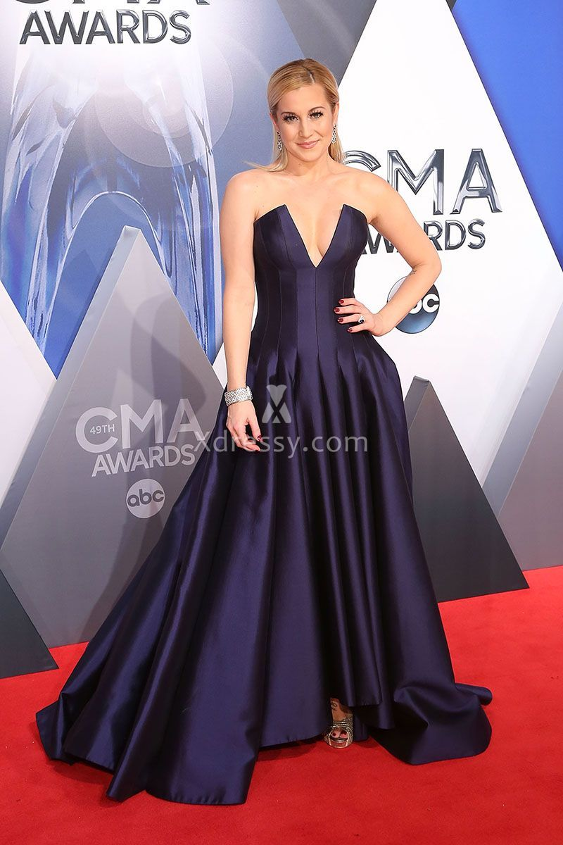 Kellie Pickler in a gorgeous grape satin ball gown at the red carpet of CMA  Awards 2015. The strapless plunging V neckline is low enough to make anyone  ... 6dab647c9