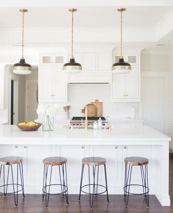 White Kitchen Features White Shaker Cabinets Paired With