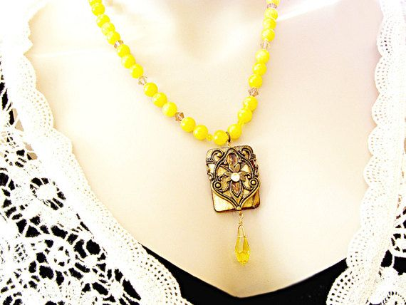 $67 Sunshine yellow necklace with Tiger Eye and filigree wrap around. Swarovski crystals complete this lovely necklace!