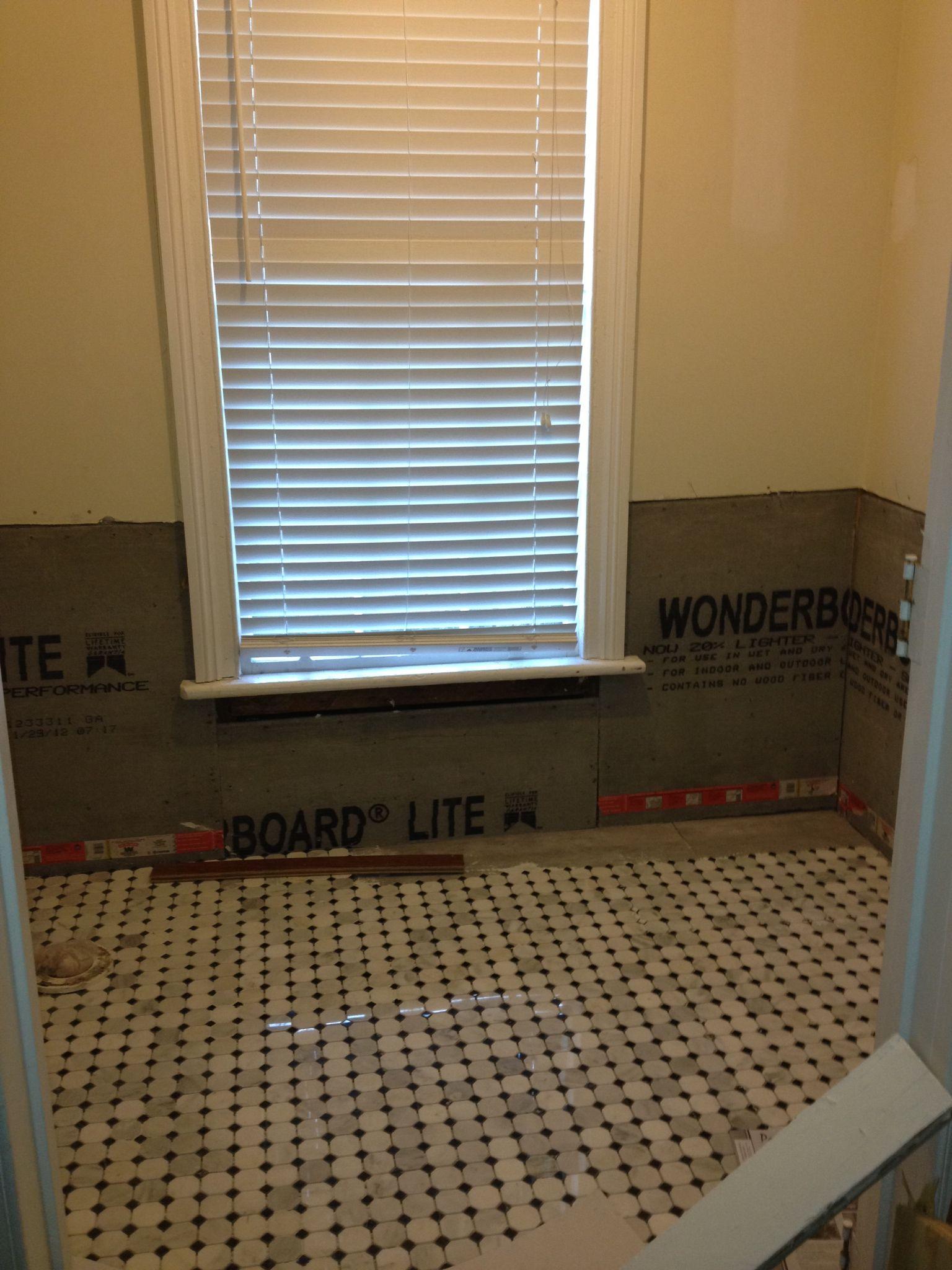 New marble floors in the half bath.