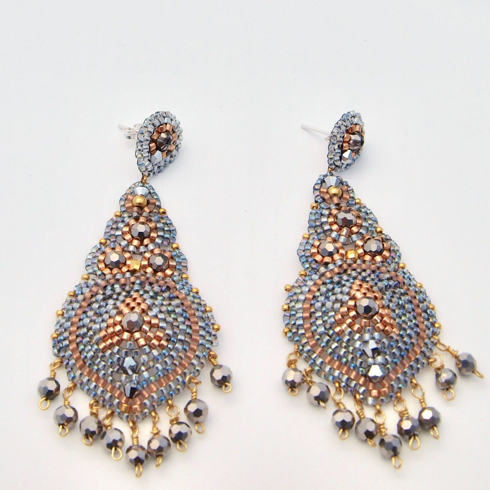 A personal favorite from my Etsy shop https://www.etsy.com/QJBoutique/listing/549120467/grey-gold-earrings-long-dangle-beaded