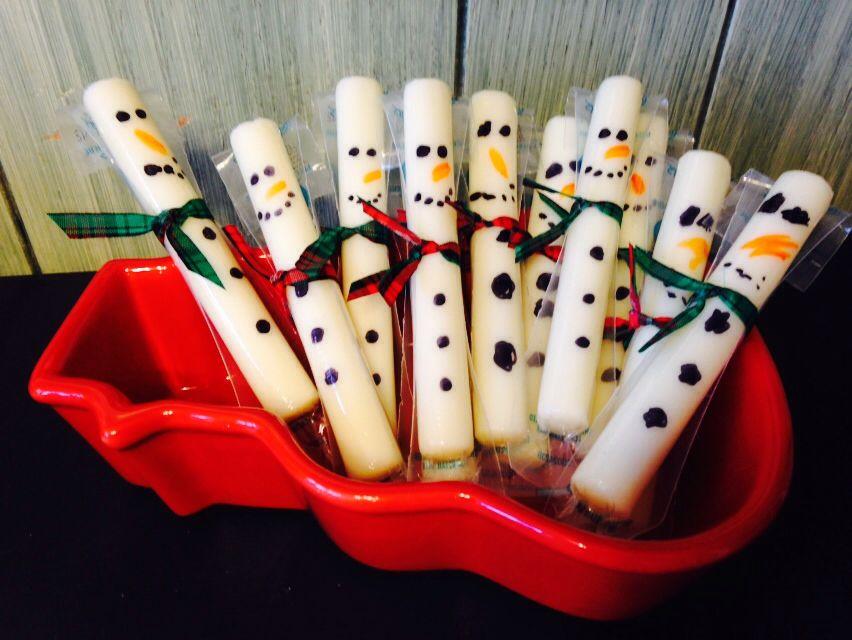 Snowmen cheese sticks in a snowman dish