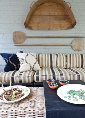 Long Baking Peels And An Old Grain Vessel Hang Above The Designed By David  Mitchell Interior Design.