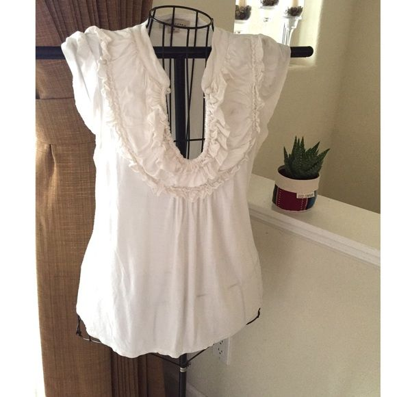 Ivory Ruffle Top Ivory top is semi-sheer cotton blend material, has a top