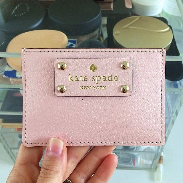 I found this beauty for $15 in the clearance bin at the Kate Spade store. I bought one for my mom and sister-in-law too!  I actually never wear a purse unless I'm working, so this is the perfect wallet to throw in the diaper bag or my back pocket! It holds all of my credit cards, my drivers license, and cash, which I always have with me.  #katespade