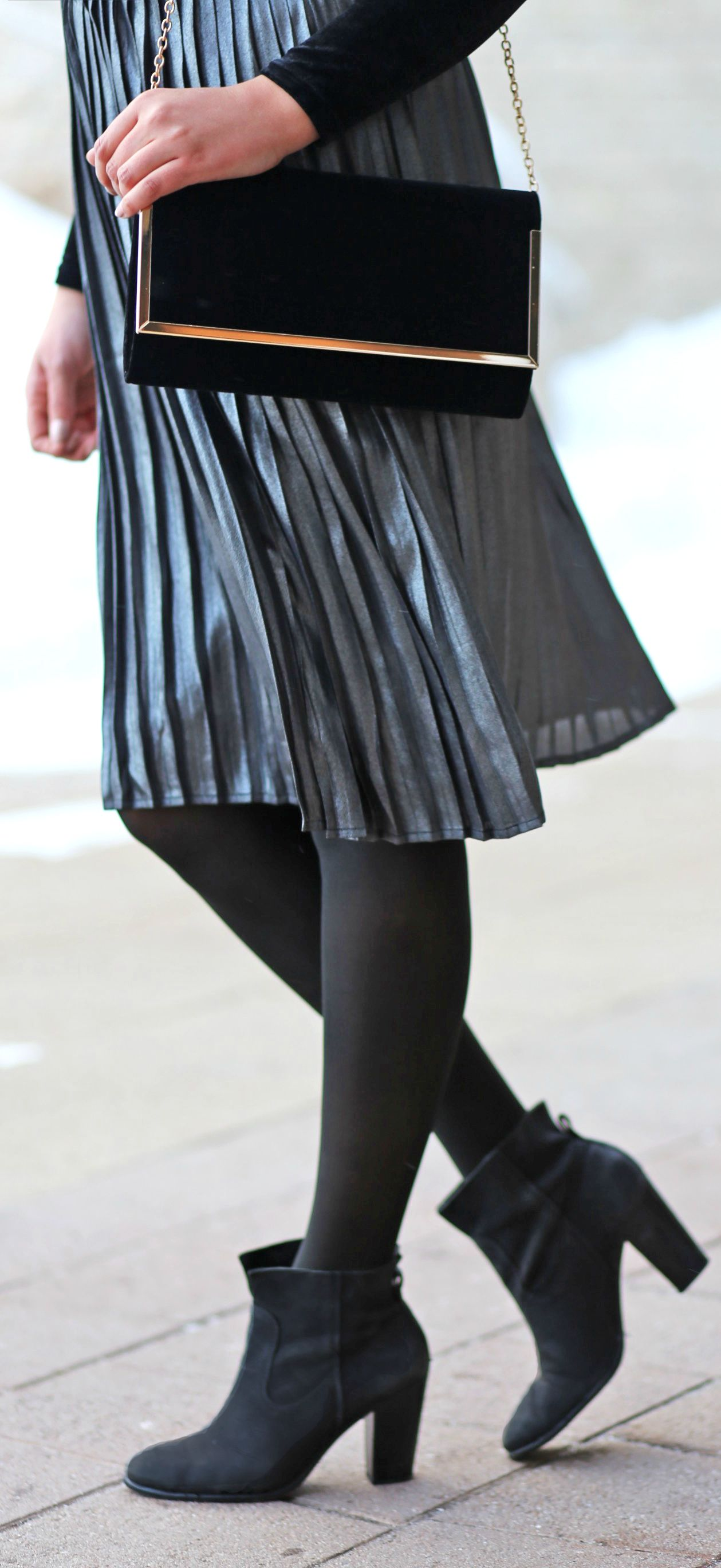8e373a407 The most stunning pleated skirt! For under $25 - it's a steal!   Fashion  blogger Mash Elle styles a @DynamiteStyle pleated skirt with a velvet  bodysuit and ...