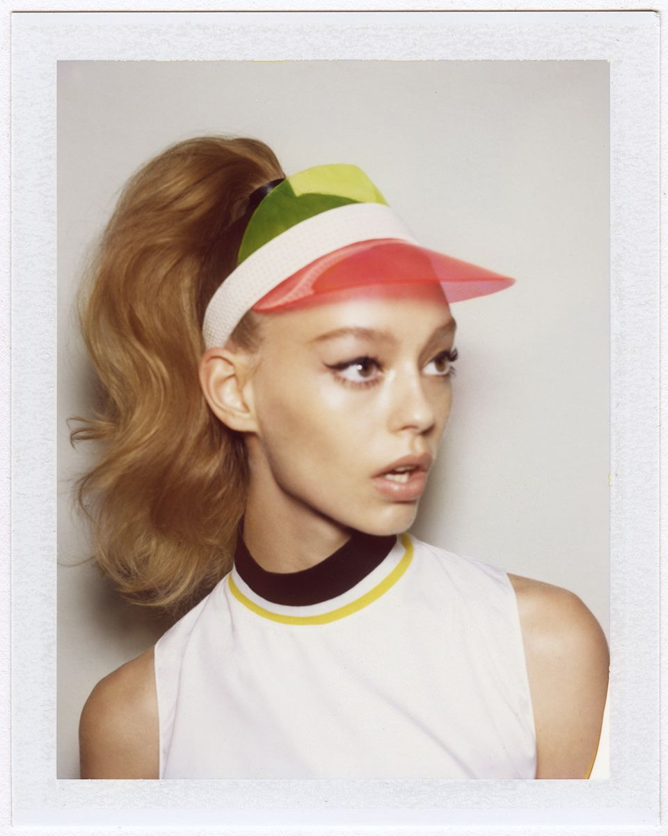 On today s beauty agenda  A high ponytail with a hint of volume and a  preppy color block visor. bd41f06aabe