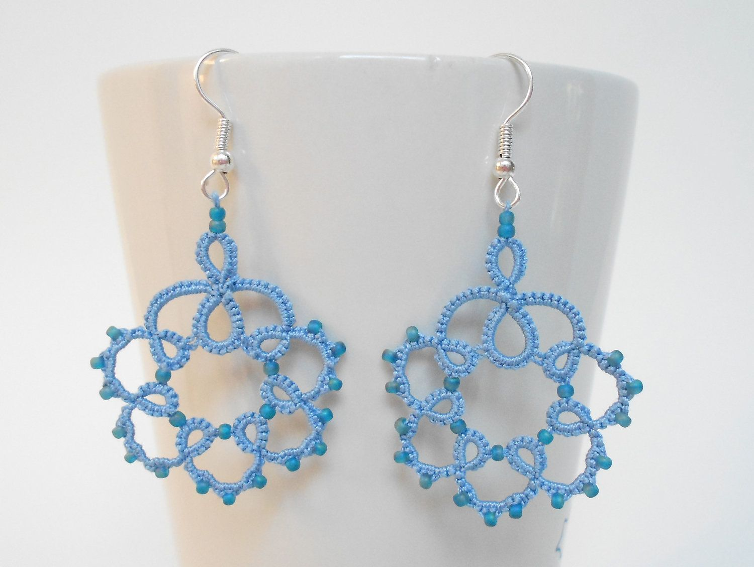 Sky blue tatted earrings with beads.