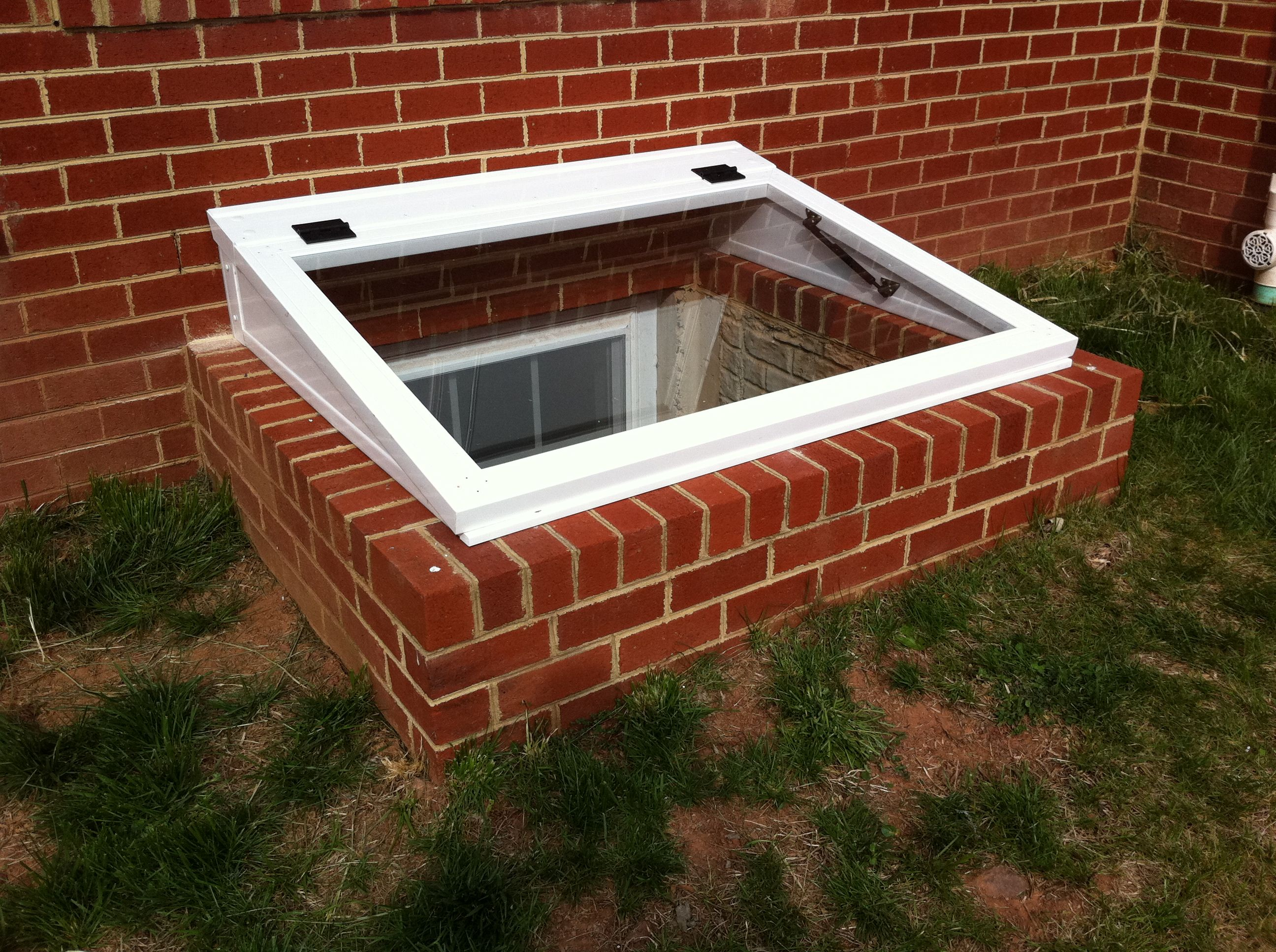 Adapter cover for existing window wells can be brick for Window cover for home