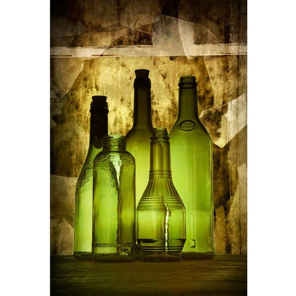 Green Vintage Glass Bottles aglow from backlighting against brown ...