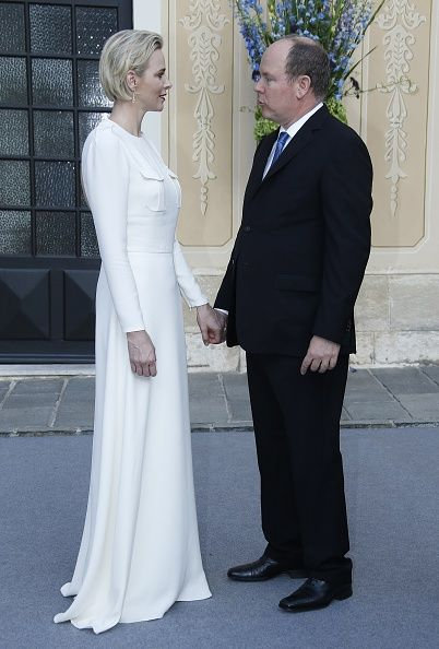 Prince Albert II of Monaco (R) and Princess Charlene hold hands in Monaco Palace during the 55th Monte-Carlo Television Festival on June 17, 2015, in Monaco.