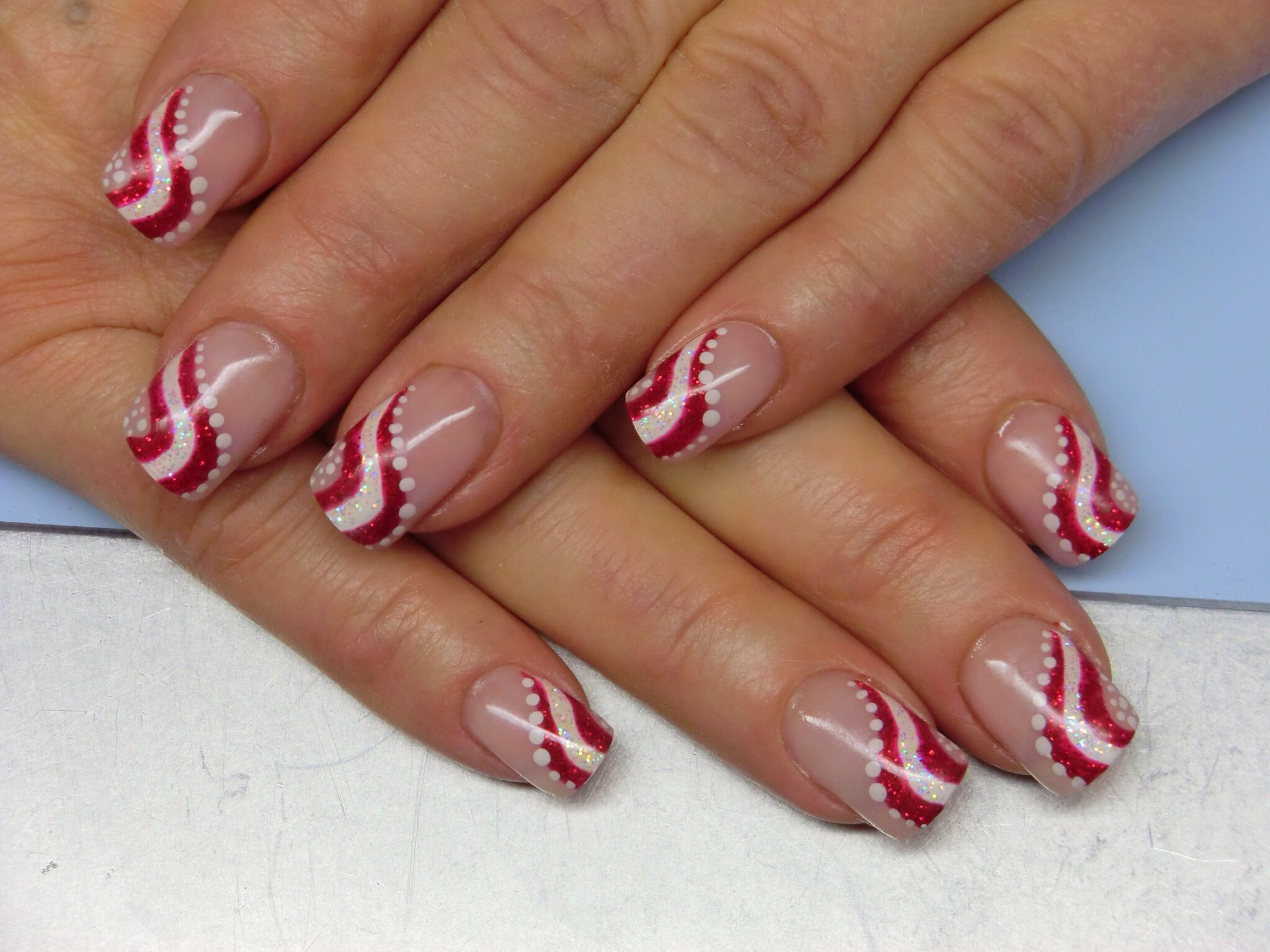 Candy cane stripes nail art design Christmas gel nails