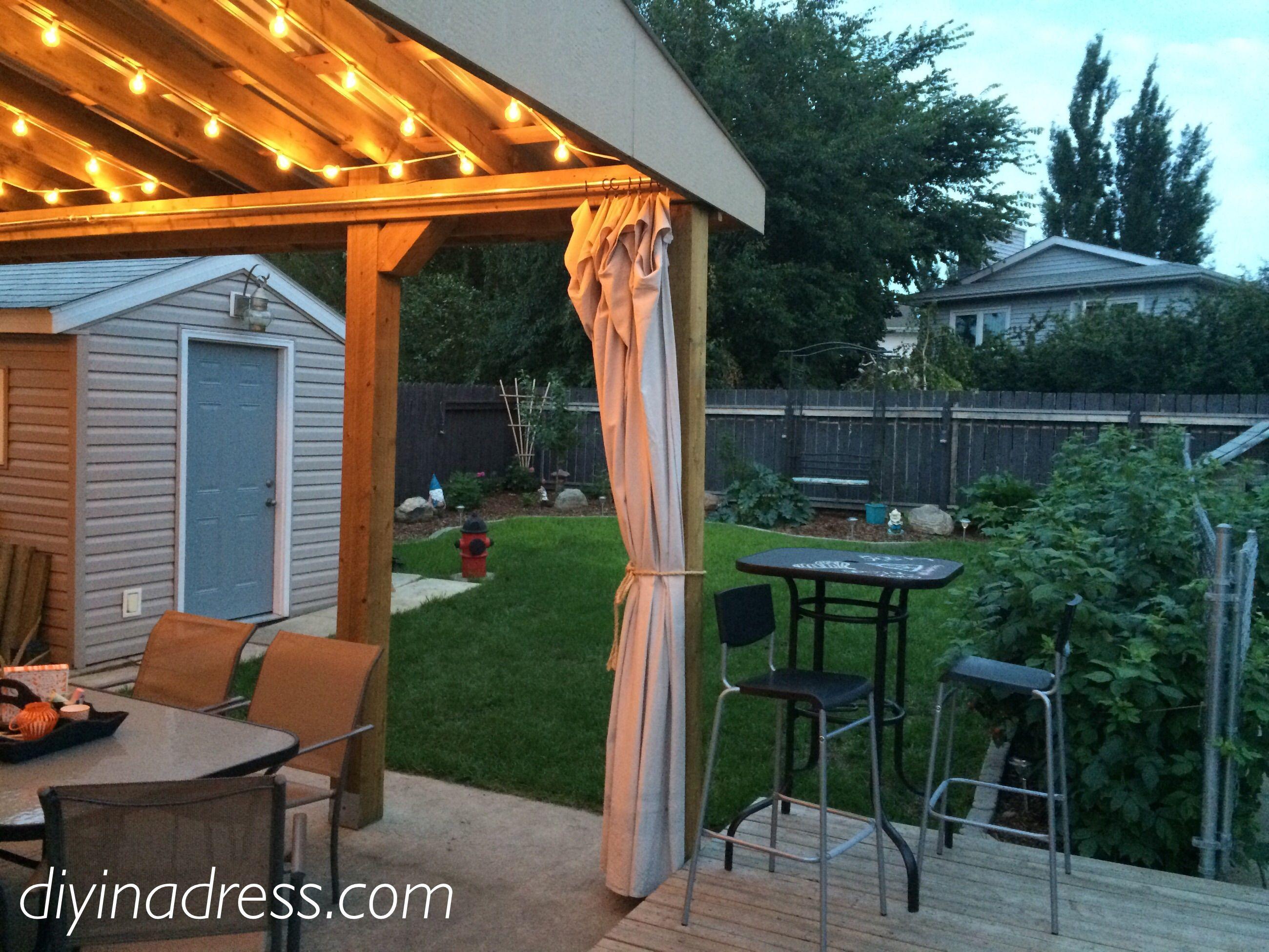 pergola inspiration; pergola lights; drop cloth curtains; back yard
