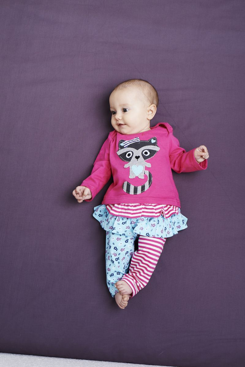 7aaed4f6e5865 Hey it s Doris Raccoon looking super cute on our new baby girls jersey top.  Team with our mixed print skeggings for top to toe fun.