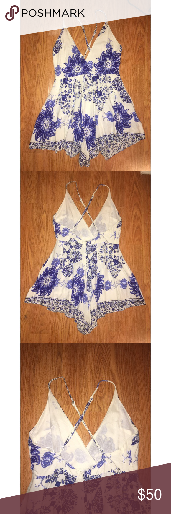 5fe42927db84 LF Blue and White floral romper NEVER WORN. Adjustable straps