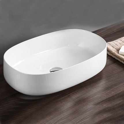 Vasque oblongue 55 x35 cm en céramique blanche à poser sur plan de