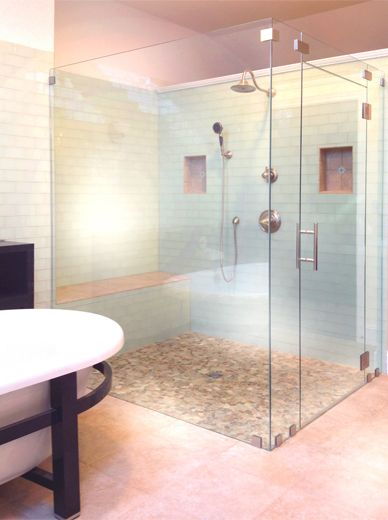 Frameless Shower Enclosure With Steam Vent Panel With Through