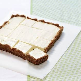 Frozen Key Lime Bars - This cool, refreshing dessert is a wonderful palate cleanser, making it a perfect ending to a rich, flavorful meal. Cut into small squares, they're easy to enjoy while mingling.