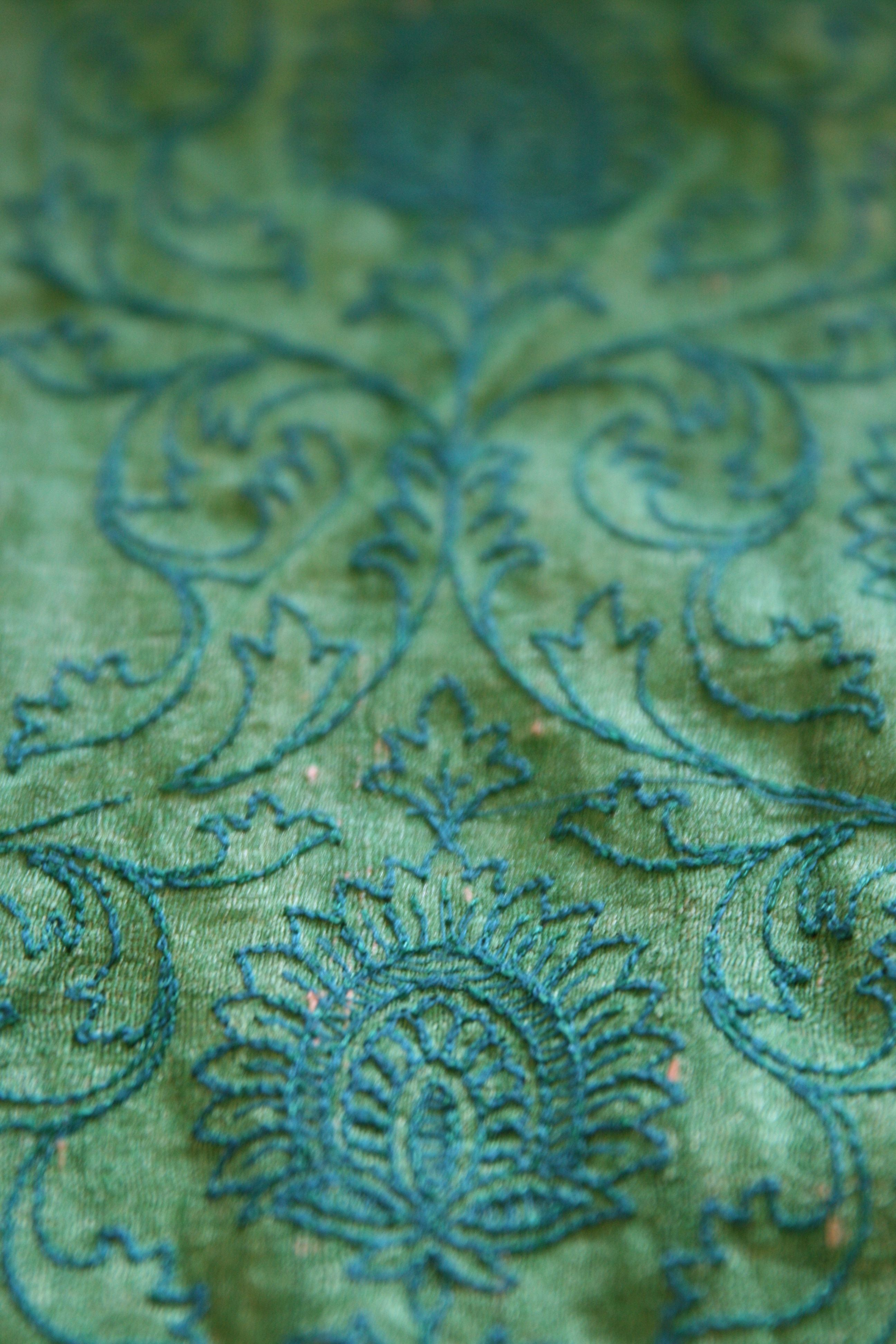 This is a rough matka silk sari and the entire sari is covered with embroidery of the same color- twining branches, lush blooms. It's exuberant yet subtle. In some places, the embroidery takes on a bluish tone and it's all very mysterious and alluring!  www.thecuratedmagazine.com