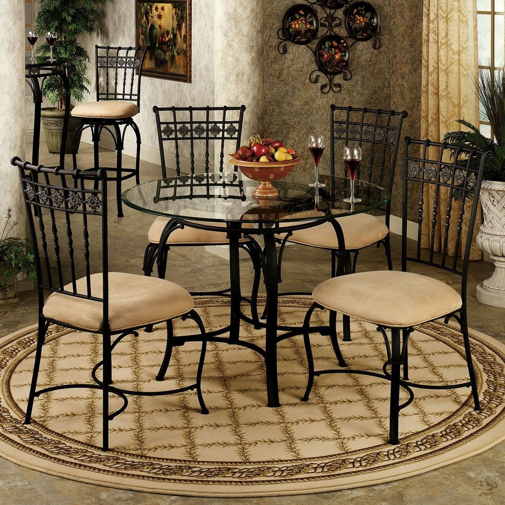 Small Wrought Iron Kitchen Table With Rounded Glass Top Combined With Artistic Dining Chairs S Classic Dining Room Glass Round Dining Table Dining Room Design