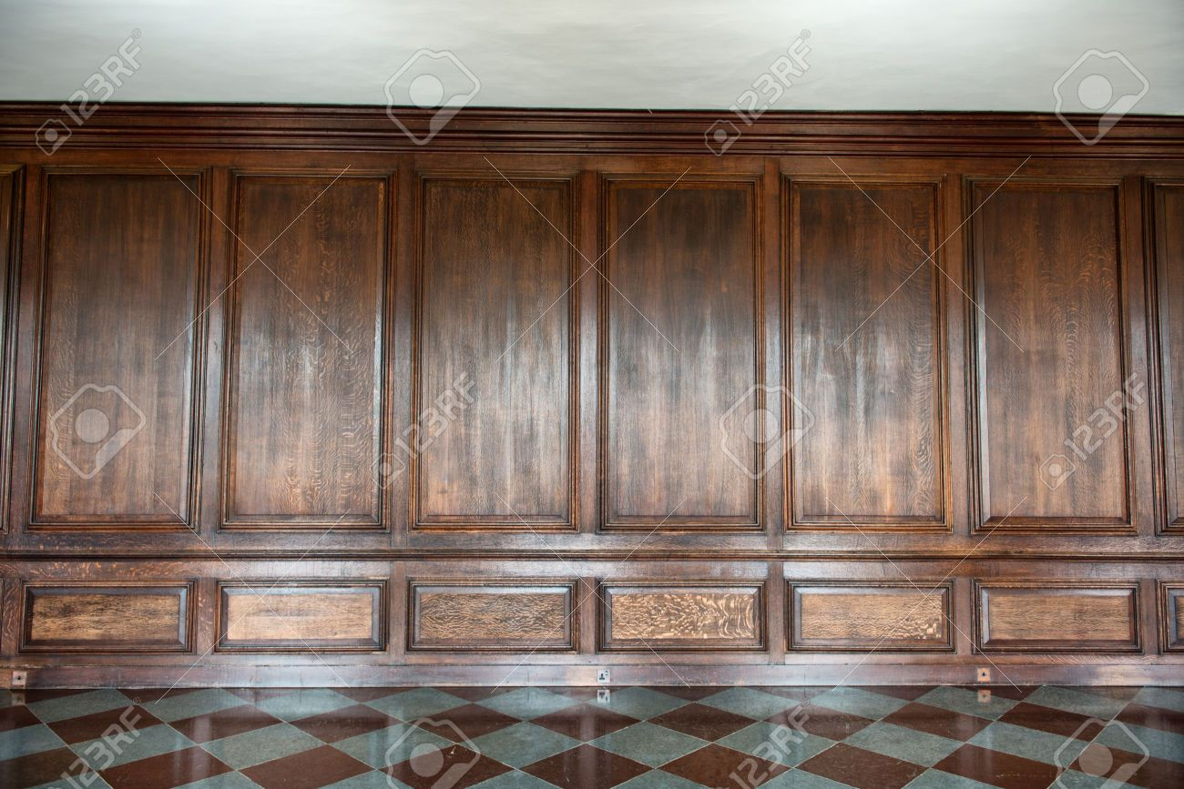 Old medieval wood paneling covering a wall in a historical country house  with a diamond pattern - Old Medieval Wood Paneling Covering A Wall In A Historical Country