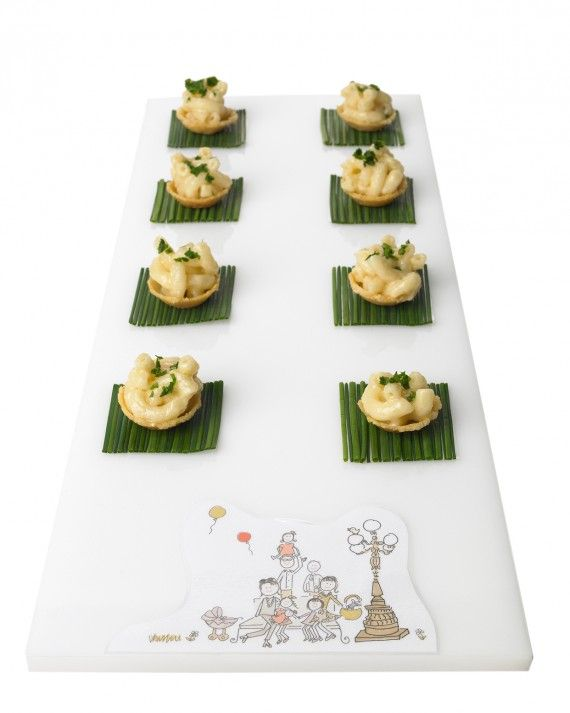 Macaroni-and-cheese bites served in a Parmesan crust are a classic example of Callahan Catering's approach to hors d'oeuvres: comfort food meets elegance, all in one bite.