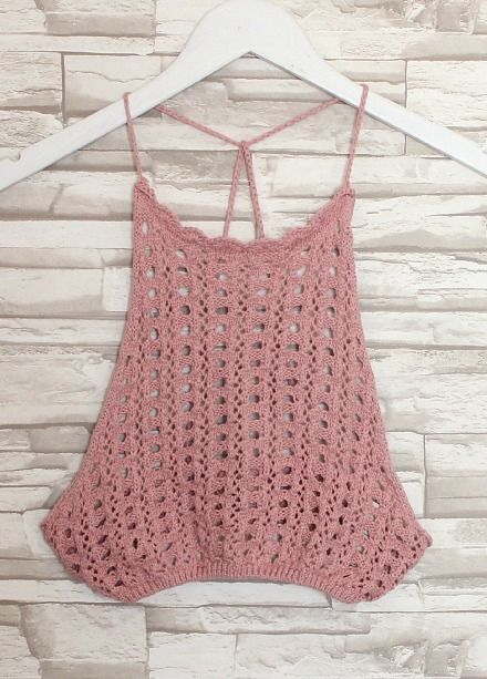 ONLY 2 LEFT!  Gorgeous halter-style crop top features high quality crochet knit all over and open strappy back. Top is fitted but super stretchy! So comfy and cute styled with highwaisted shorts or flowy ruffle shorts. Makes for a perfect festival-inspired #ootd!   MADE IN USA