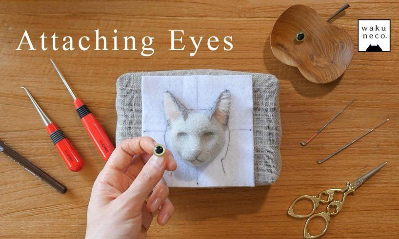 japanese artist creates incredibly realistic cat heads out