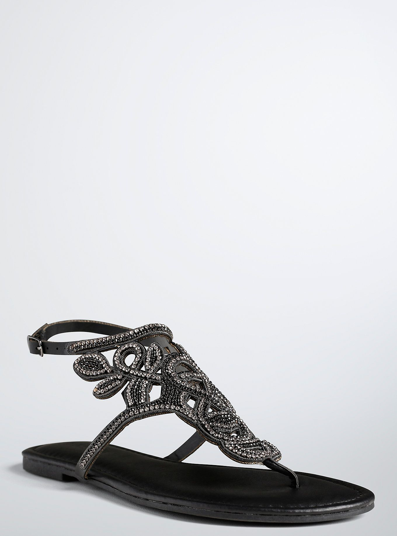 5e79e411f043 ... and bedazzling flat sandals. Smooth faux leather lines the sole  (keeping your foot feeling luxurious)