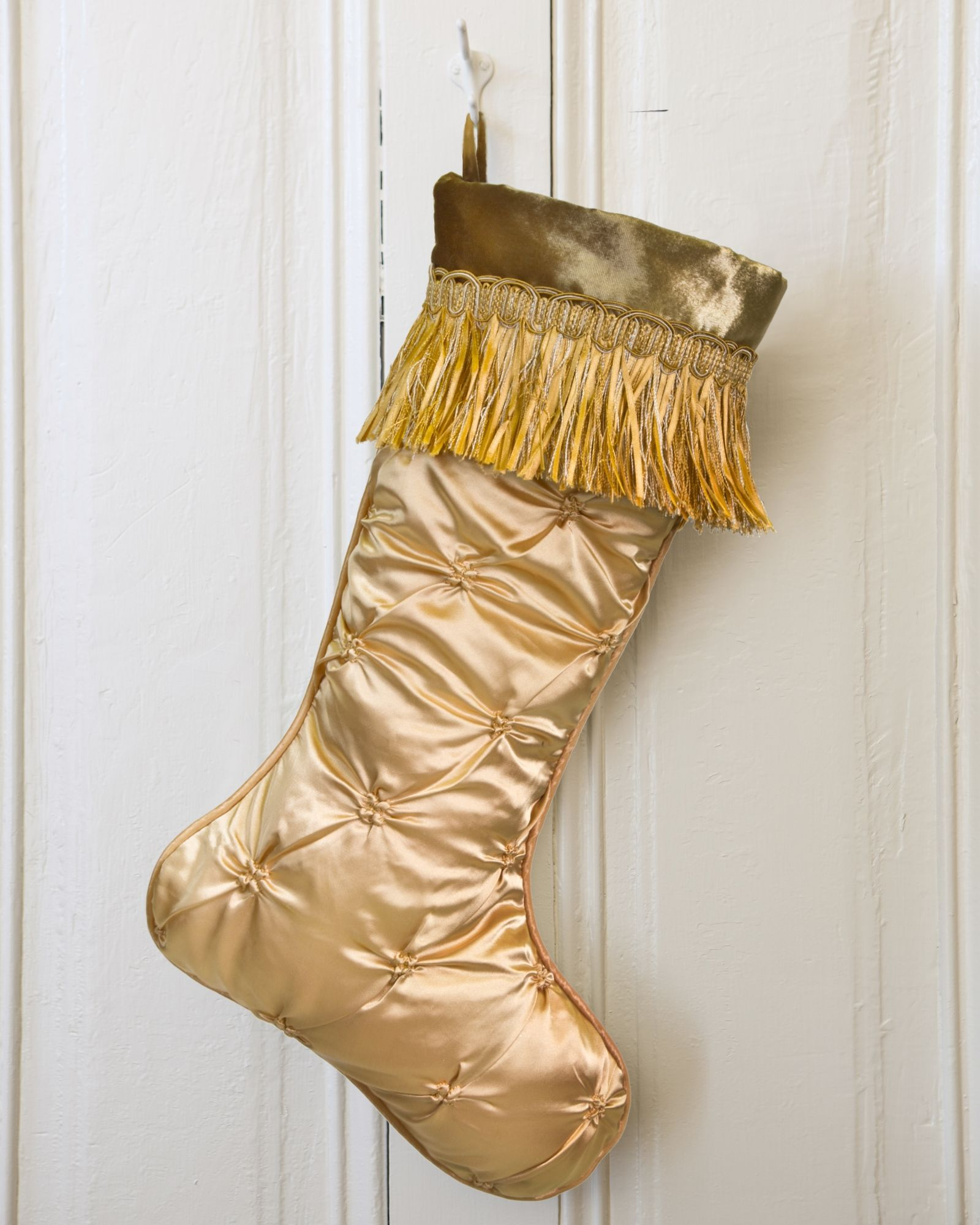 Crafted from soft faux silk and featuring textured pintuck pleats, this Gramercy Park gold stocking is a shimmering sight.