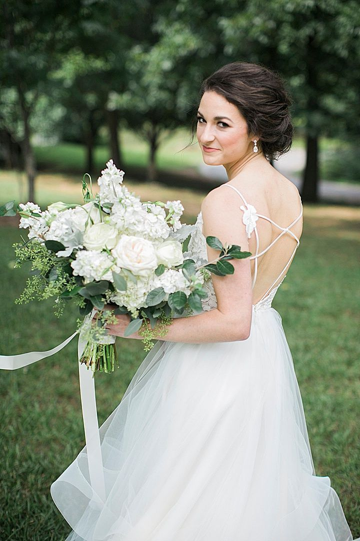Hayley Paige wedding gown, ivory and green bridal bouquet at outdoor ...