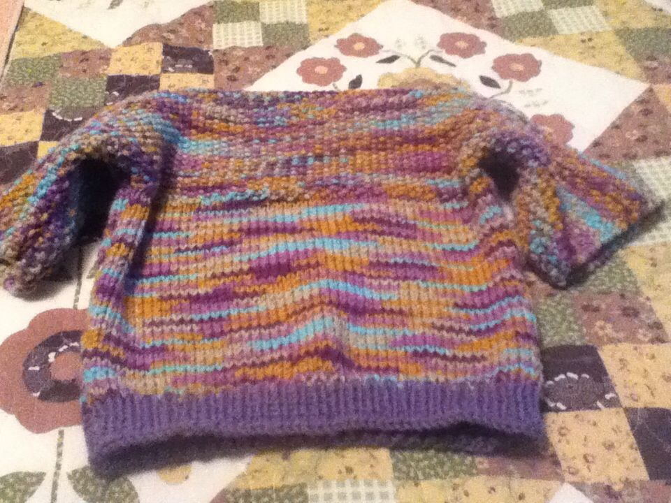 Hand knit sweater for Donation.