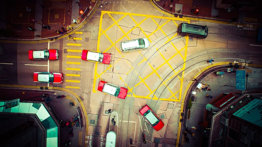 Aren't these all great shapes? Even though I was standing on the ground down there, I didn't think it would look this cool. I was too busy trying to avoid those wires that are over the intersection that the electric buses use. I can't imagine it would be a good move for the DJI to touch one of them! - Hong Kong, China - Photo from #treyratcliff Trey Ratcliff at http://www.StuckInCustoms.com