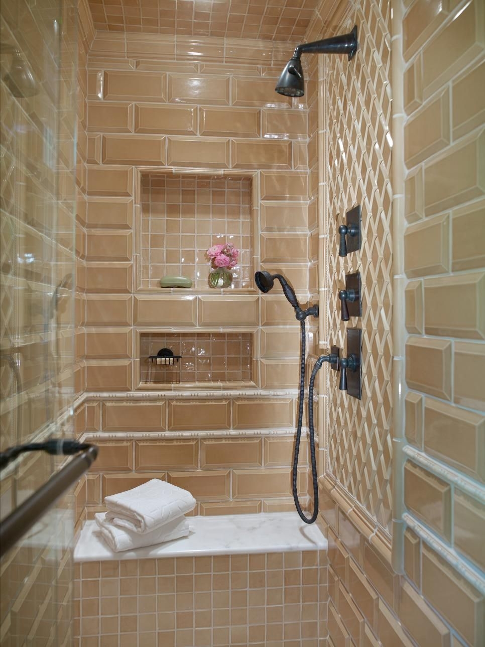 Terra cotta-colored glass tiles line the inside of this enclosed ...