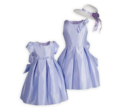 Springtime Lilac Matching Sister Dresses Beautiful lilac  satin sister dresses with bow accents. Made in USA exclusively for The Wooden Soldier.