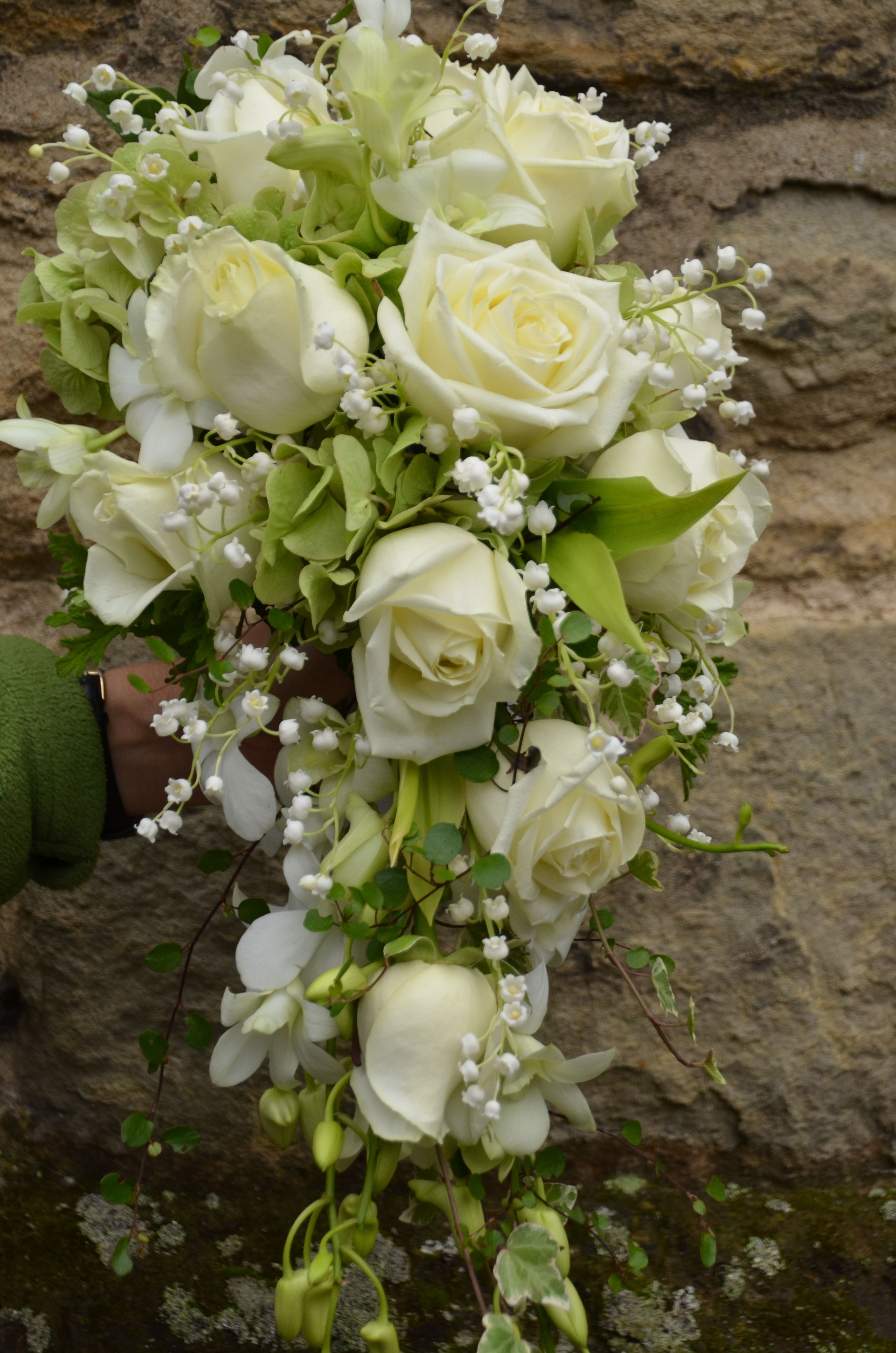 Tailing shower bouquet of roses and lily of the valley butonnieres tailing shower bouquet of roses and lily of the valley izmirmasajfo